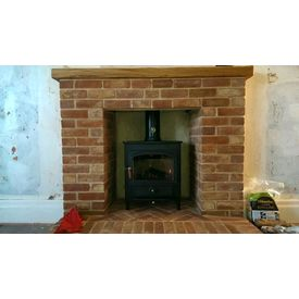 Clearview Vision 500 8kw stove in a brick fireplace built by Kevin Block
