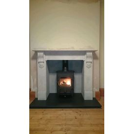 Carrara marble Nuffield mantel and honed granite hearth
