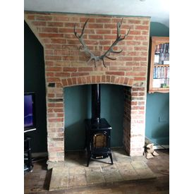 Exposed brick chimney breast and reclaimed pamments