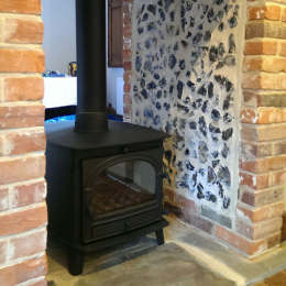 Parkray Consort Double Sided Stove with new fireplace finished in flint panels